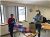 Bernice and Elizabeth filling packets